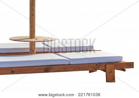 Two Empty Sun Bed At Small Pebble Stone Beach For Relaxation Isolated On White