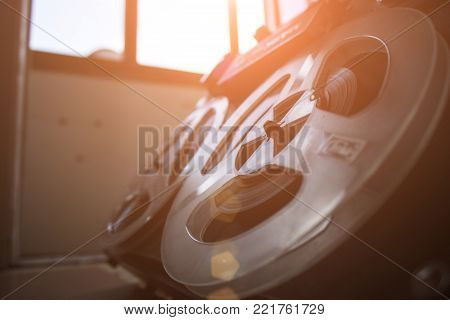 Old tape recorder is playing music, close up