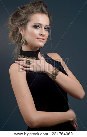 Beautiful young woman with evening make-up. Jewelry and Beauty. Fashion photo