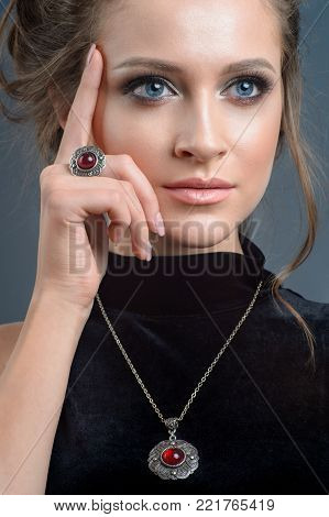 european style model wearing luxury accessory from silver. Isolated on dark blue background
