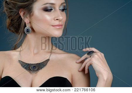 fashion woman with jewelry set. girl with fashionable jewelry necklace earrings and ring