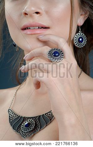 silver ring on finger. Close up female model wearing ethnic jewelry