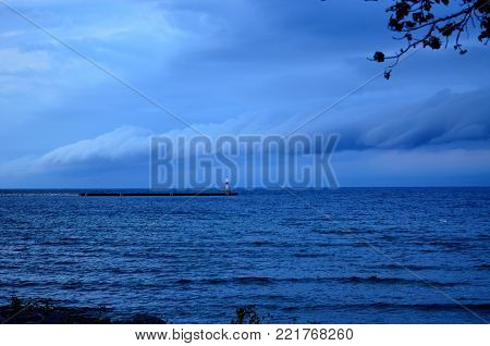 Storm clouds and shelf clouds rolling over the water on a summer evening