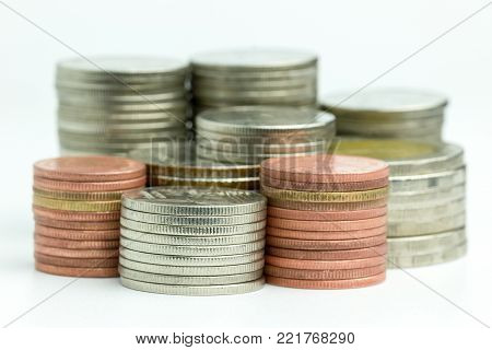 Closeup the coins are stacked neatly on a white background. Suitable for use in business or financial articles.