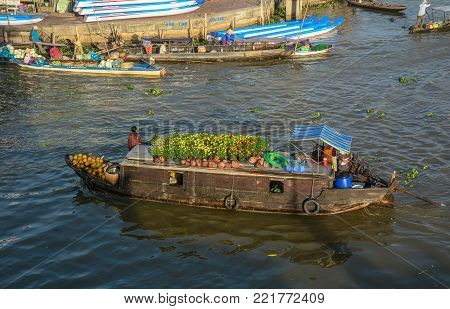Mekong Delta, Vietnam - Feb 2, 2016. Wooden boats at Nga Nam floating market in Mekong Delta, Vietnam. Nga Nam is one of many famous floating markets in the south of Vietnam.