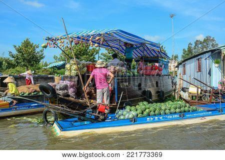 Soc Trang, Vietnam - Feb 2, 2016. People with boats at a floating market on Mekong River in Soc Trang, Vietnam. Mekong is the longest river in Southeast Asia, the 7th longest in Asia.