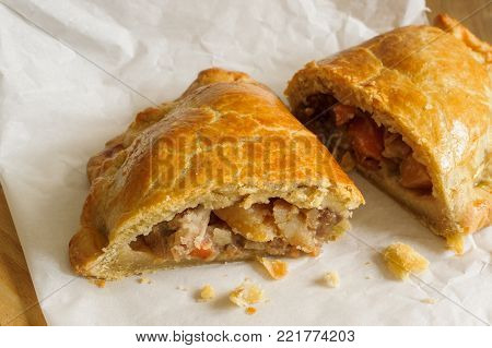 Welsh Oggie a regional delicacy from Wales of lamb leeks and vegetables baked in a short crust pastry case similar to a Cornish pasty