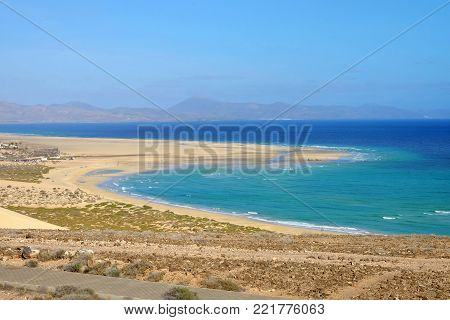 View on famous beach Playa de Jandia - Playa de Sotavento - Playa Lagoon on the Canary Island Fuerteventura, Spain. This beach belongs to the best beaches in the world for windsurfing.