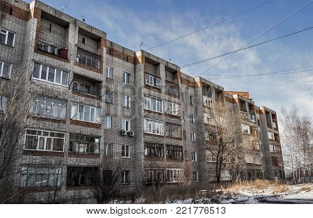 Old brick apartment building. Grunge urban background. High-rise building. Apartment block