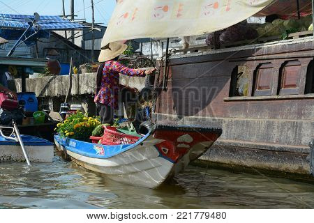 Soc Trang, Vietnam - Feb 2, 2016. Cargo boats docking on Mekong River in Soc Trang, Vietnam. Mekong is the longest river in Southeast Asia, the 7th longest in Asia.