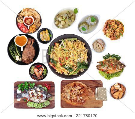 Food to respect God of fortune in  Chinese new year, such as fish, pork, shrimp, crab, bamboo shoots, tofu, desserts and fried yellow noodle in  Chinese style placed on red velvet cloth. Isolated