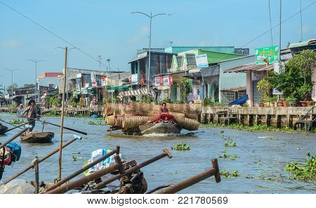 Soc Trang, Vietnam - Feb 2, 2016. Nga Nam Floating Market on Mekong River at sunny day in Soc Trang, Vietnam. Mekong is the longest river in Southeast Asia, the 7th longest in Asia.