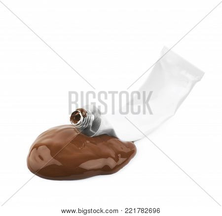 Used paint tube lying in a dye spill splash, composition isolated over the white background