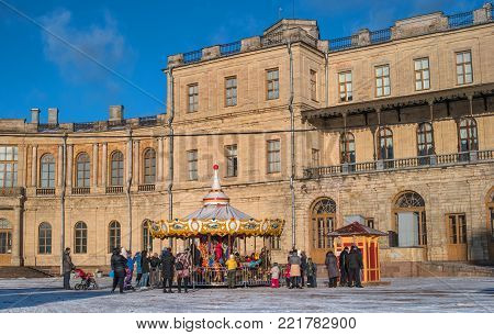 Gatchina, Russia - January 7, 2018: Gatchina Palace, New Year's Fair on the parade ground. Children's carousel at the fair.