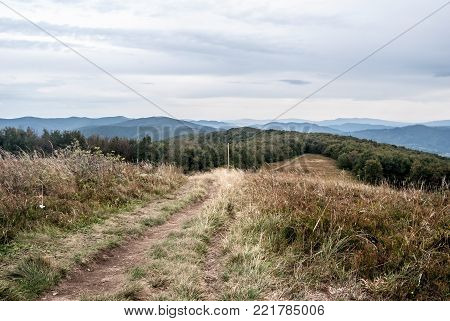 panorama of wild Biesczady and Bukovske vrchy mountains with hills, mountain meadows, deep forests and no civilsation from Jaslo hill in Bieszczady mountains in Poland
