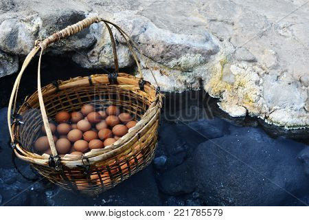 many egg in bamboo basket in hot water in hot springs at Chae Son National Park in Lampang Province, Thailand