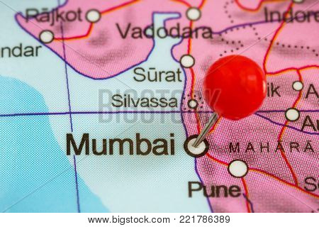 Close-up of a red pushpin on a map of Mumbai, India.