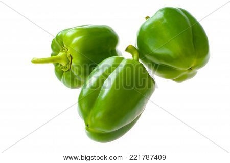 Ripe green bell peppers. Isolated on white background