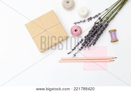 Bouquet of lavender and gift box on a white background. Mothers Day