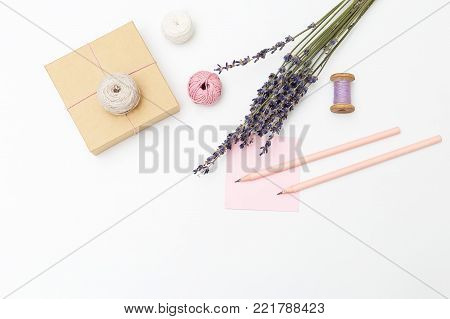 Bouquet of lavender and gift box on a white background. Copy space