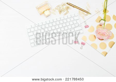 Styled feminine desk and accessories. Copy space