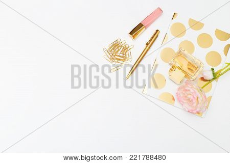 Styled feminine  gold&pink accessories. Copy space office desk