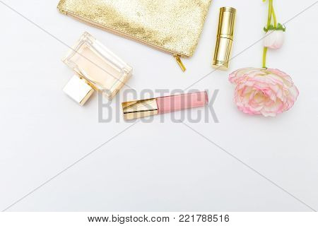 Cosmetics for make-up pink with gold on a white background. Copy space