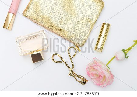 Cosmetics and accessories pink&gold on a white background. Lifestyle flat lay