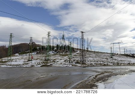 Electric power transmission line in winter, Plana mountain, Bulgaria