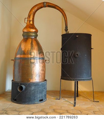 GRASSE, FRANCE - OKTOBER 2017: Ancient distiller for production of perfume in Fragonard factory in Grasse, France