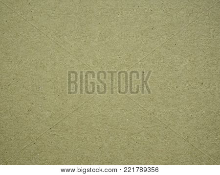 Background. Texture. Sheet of cardboard yellow-beige. Inhomogeneous inclusions. Solid, even paper made of pressed fibers.