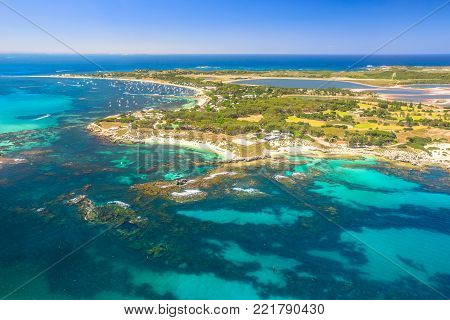 Aerial view of Rottnest Island in Australia, on a sunny day. Scenic flight over famous tourist destination of Western Australia. Rottnest Island is located near Fremantle and Perth. Copy space.