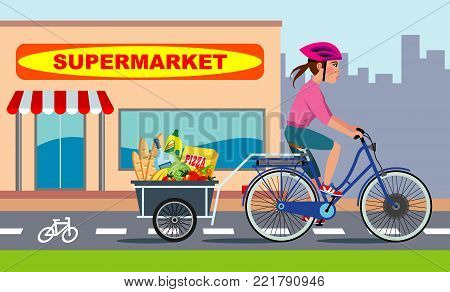 girl riding electric bike with bike trailer full of grocery, runs along a bicycle lane