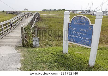Southport, NC, USA - July 28, 2014: Southport Salt Marsh Boardwalk and Waterway Overlook entry sign. Southport Salt Marsh Boardwalk and Waterway Overlook.