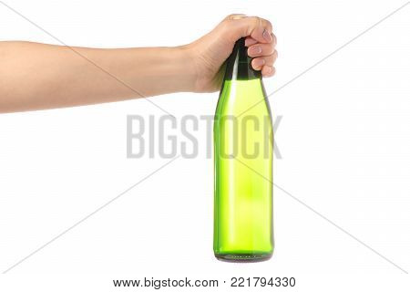 Glass bottle of soda water in hand on a white background isolation