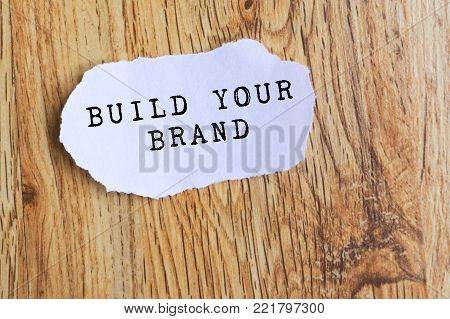 Piece of paper with Inspirational Quote - Build your brand.