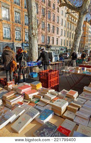 LYON, FRANCE, January 13, 2018 : Secondhand booksellers of the Quai de la Pecherie on Saone river banks in Lyon.