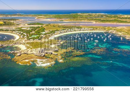 Scenic flight, Australia, Indian Ocean. Aerial view of Pink lake and Geordie Bay on Rottnest Island, a popular tourist destination of Western Australia. Rottnest Island is near Fremantle and Perth.