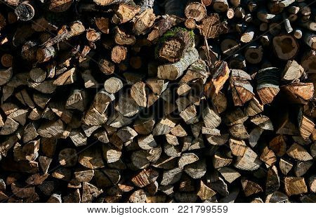 Firewood background. Pile of firewood. Stacks of firewood for the winter