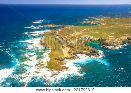 Aerial view of West End, the most popular western point of Rottnest Island, Australia, a rugged piece of coastline famous for waves, wind and seals. Scenic flight over famous tourist destination of WA