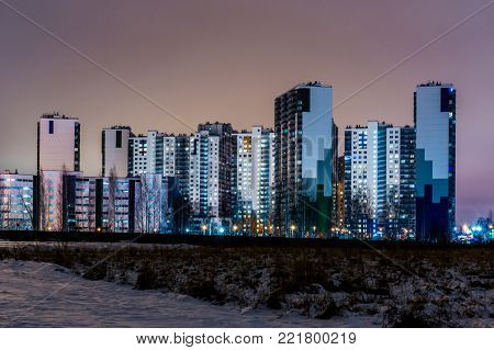 The night view on the new buildings on the suburb of the big city from the heath