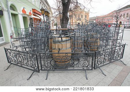 The restaurant is closed on the street of the city. The iron fence isolates the restaurant area. Chairs and tables are complex disorderly. In the winter the ambience of the restaurant is sad.