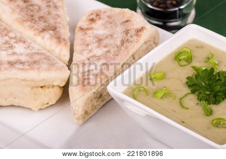 Potato and Leek Soup. Traditional Irish soup eaten as a snack meal or starter course, here with Sourdough bread and Irish Stout.