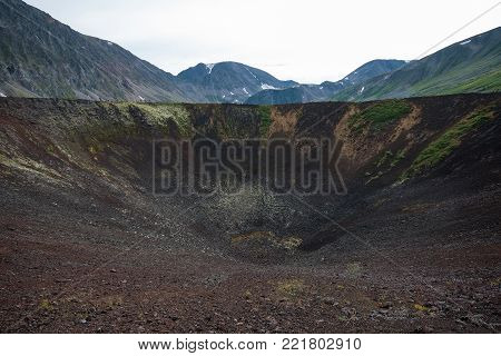 Old volcano crater, scenic summer landscape. Vulcan valley, Eastern Sayan mountains, Russia, Siberia