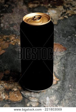 Aluminium can of stout beer top with on stone background
