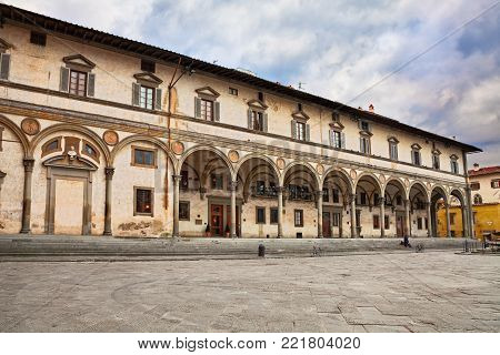 FLORENCE, ITALY - FEBRUARY 22, 2017: The square of Santissima Annunziata whit the ancient palace Loggia dei Servi di Maria. Photo taken on February 22, 2017 in Florence, Tuscany, Italy