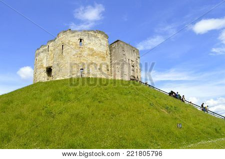 York, Yorkshire, England, UK - May 22, 2016 : The historical York Castle in the city of York commonly referred to as Clifford's Tower