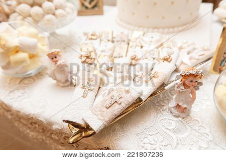 Accessories for the christening of children icons of candles and font, the Christian Armenian Church. The Sacrament of Children.