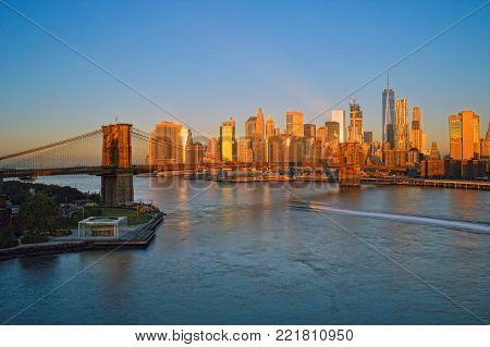 Manhattan skyline with Brooklyn Bridge at sunrise - HDR image.