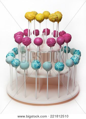 Three-tiered stand holder with multi-colored cake pops